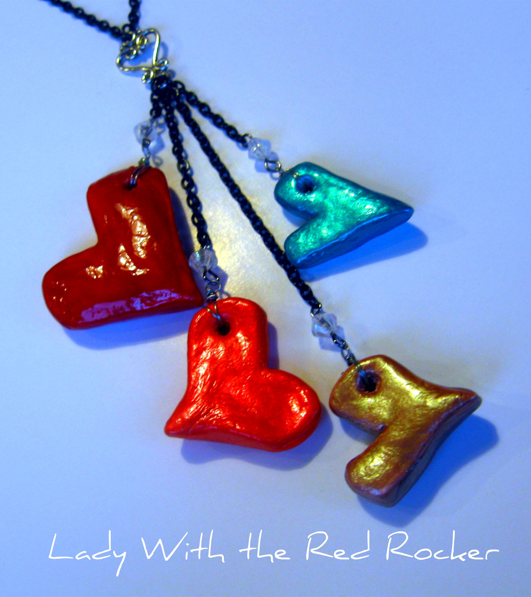 Salt dough heart necklace lady with the red rocker d then i smoothed and continued to form the hearts until i liked how they looked after that i poked a hole in them so i could make my necklace aloadofball Choice Image